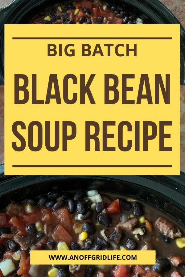 Black bean soup recipe text overlay on soup in black bowl with chunky tomatoes, corn and black beans