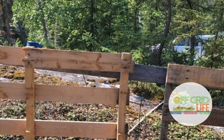 Upright wooden skids on an off grid homestead