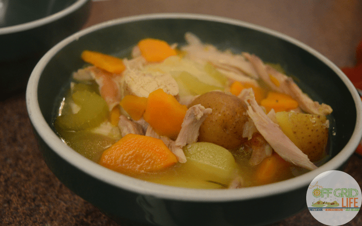 a rabbit stew in a green bowl