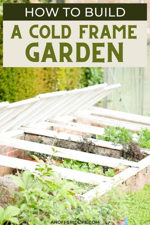 """a pinterest image of a white cold frame garden with a brick bottom and text overlay """"how to build a cold frame garden"""""""