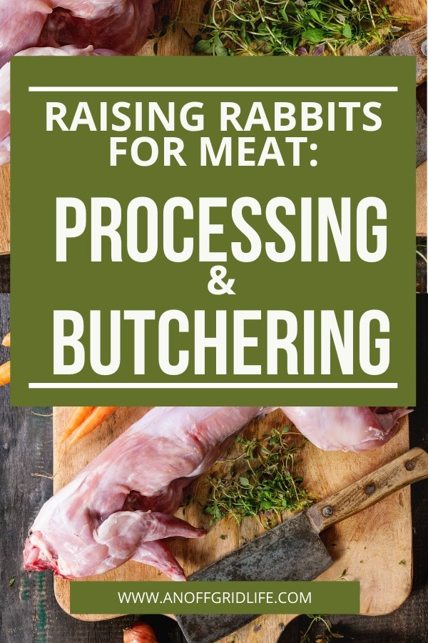 Rabbit meat with herbs and carrots and a cleaver on a wooden cutting board