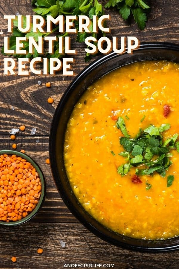 text overlay turmeric lentil soup recipe, with a picture of a bright orange bowl of soup on a wooden table.