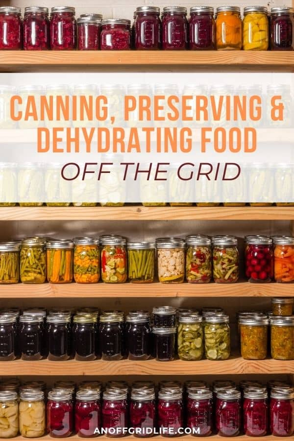"""text overlay """"canning preserving & dehydrating food off the grid"""" on a picture of several shelves of canned preserves."""