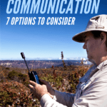 A pinterest image of a man holding a satellite phone in a field.