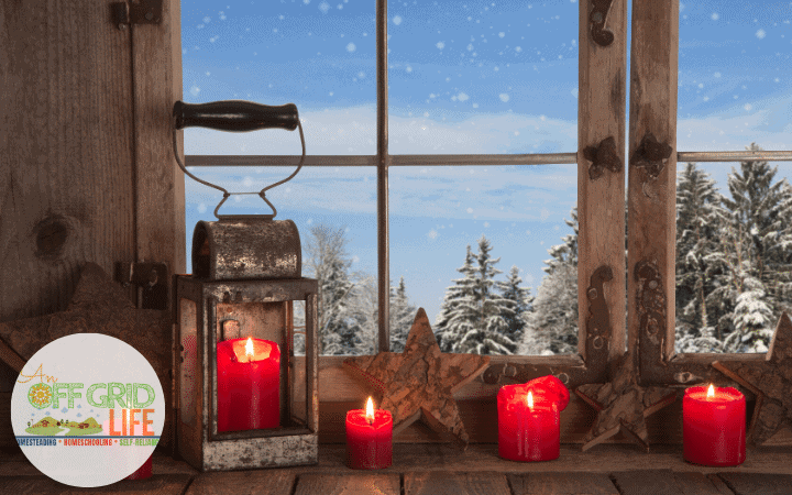Red candles in a cabin window