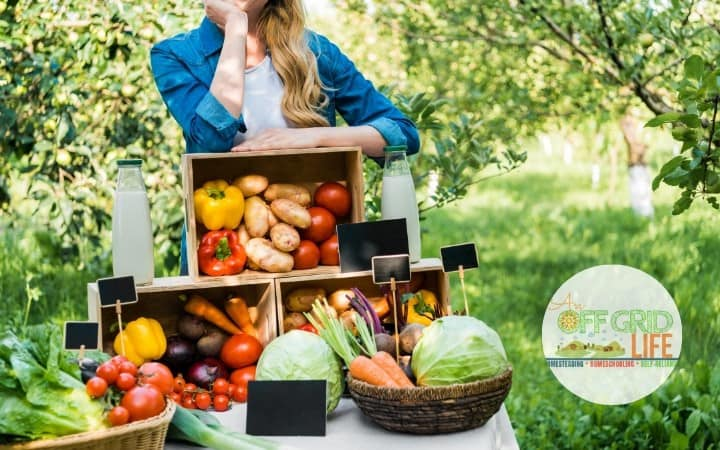 woman outdoors with crates of fresh vegetables