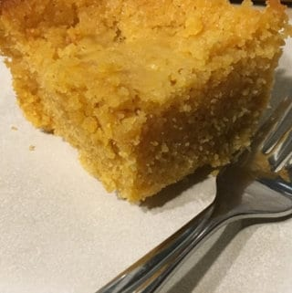 This easy honey graham cornbread recipe uses vinegar, skim milk powder and water for a lighter-than-usual old-fashioned family favourite! #honeygrahamcornbreadrecipe #grahamcornbread #cornbreadrecipe