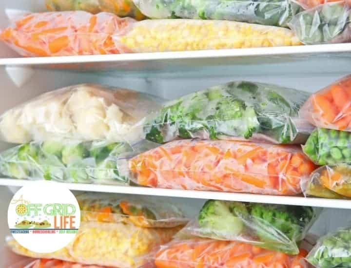 Frozen vegetables in freezer bags on freezer shelves