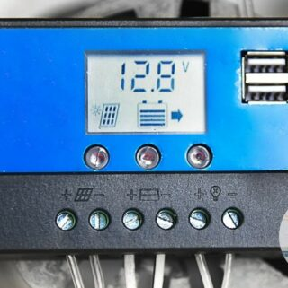 Charge controller on a wall showing voltage