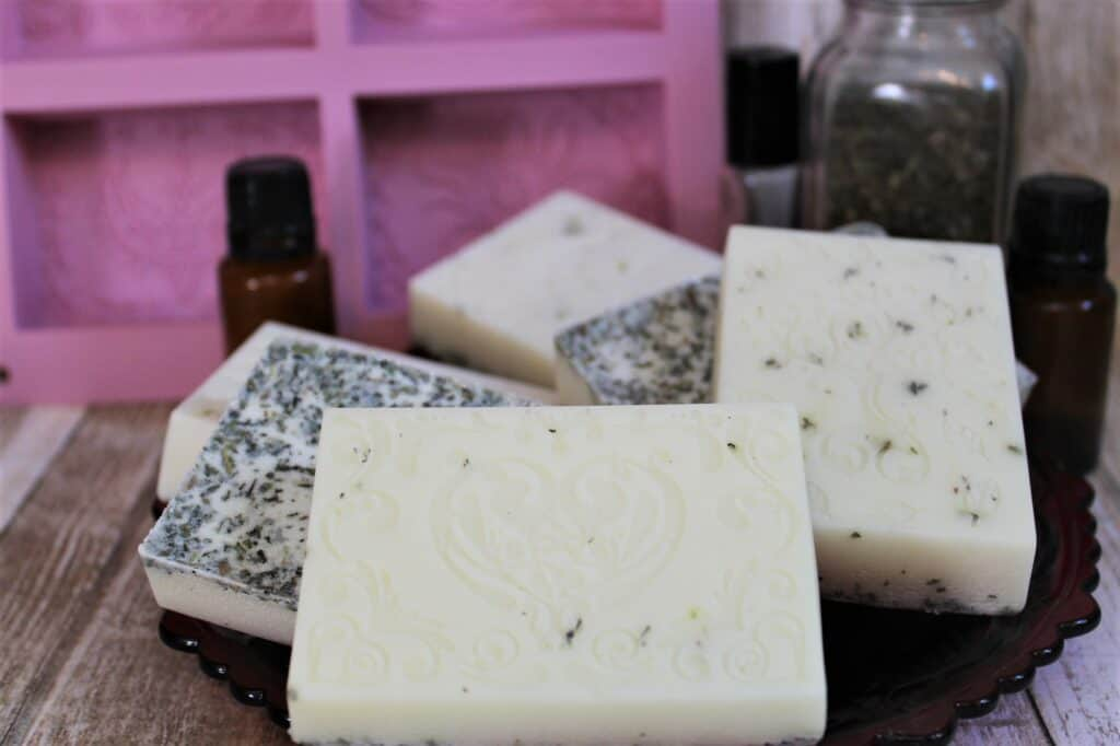 Goat milk soaps for sinus relief homemade soap bars with essential oil and mold in background