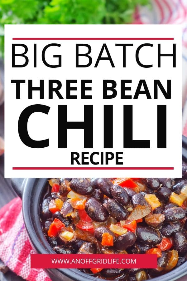 Big Batch three bean chili text overlay on black bowl of chili wiht corn and red peper