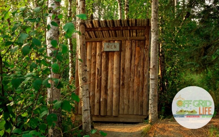 An outhouse in the woods