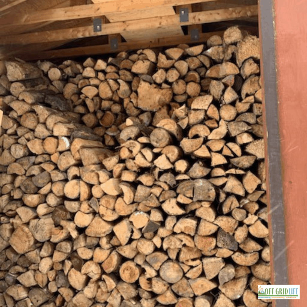 a large stack of split and dried wood in an off grid wood shack