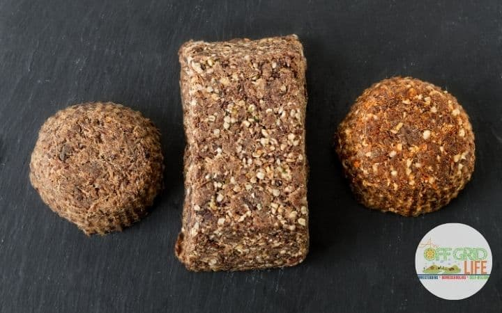 a picture of three pieces of pemmican with a black background.