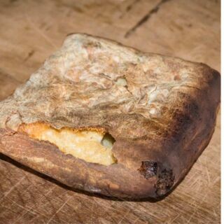 Hardtack loaf on a wooden tabletop