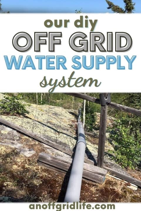 Our diy off grid water supply system above ground pipe going over rock down to the lake
